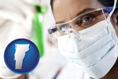 vermont map icon and an environmental testing lab technician